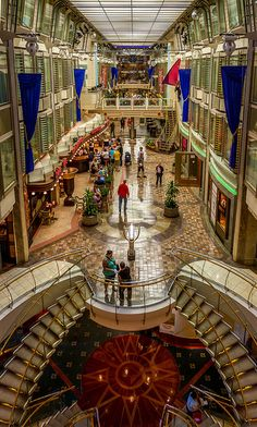 Royal Promenade on Navigator of the Seas. Photo by Brian Leadingham. #royalcaribbean #ship #cruising
