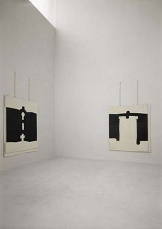 Photo of two of Eduardo Chillida's Gravitaciónes hanging in a gallery (no further information available).