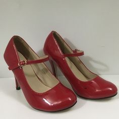 """Modesta Mary-Jane Heels in Red Patent Leather Barely worn Mary-Jane style heels in red patent leather.  Shoes have a glossy finish finish and round toe.  Heels are approximately 3.25"""" high.  Although these shoes have been worn only once, each shoe sports a small (no larger than one centimeter) black scuff on the inside toe. Shoes Heels"""
