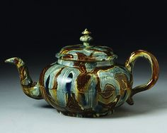 Staffordshire teapot, solid agate ware with lead glaze 1740 – 1750.    British Galleries