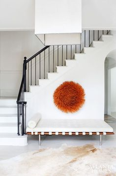 minimal, but love the mod day bed and pop of rusty orange as the only wall art,.......