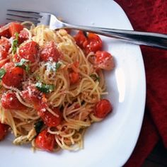 Pasta with a simple yet delicious sauce made with grape tomatoes and garlic