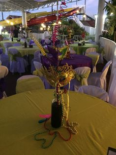 Sample of a table center piece with Mardi Gras themed party