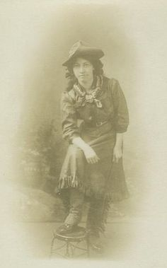 Antique real photo postcard of a cowgirl circa 1910.