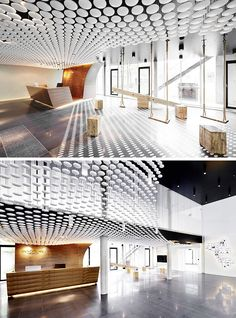 13 Amazing Examples Of Creative Sculptural Ceilings // The entry way of the INNOCEAN Headquarters is filled with white circles.