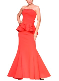 In an eye-catching shade of red, this striking two-piece neoprene dress from Mandira Wirk offers bold style and elegant details that make it perfect for any special occasion. The strapless top features clean lines with a low back, a bow accent at the back waist and a peplum hem trimmed with a cut out floral pattern. The matching trumpet skirt hugs the body and flares out at the knee to offer unparalleled style.
