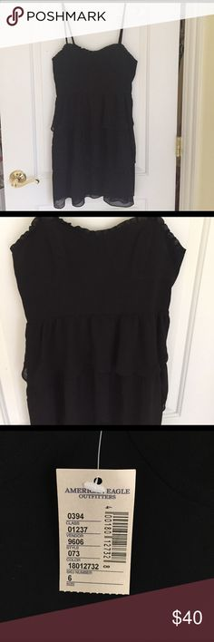 American Eagle Black Tiered Dress Black dress with three tiers and cute ruffle detail along the top. New with tags. American Eagle Outfitters Dresses