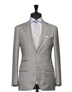 This cloth is a bright blue tropical houndstooth. Cloth Weight: 200 gram Composition: 48% Cotton, 44% Wool and 8% Silk. Shown here made up as a two piece suit with notch lapels, flap pockets and two and a 1/2 buttons.