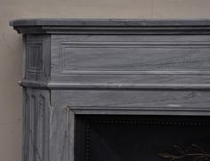 Antique Louis XVI style fireplace with round edges in Turquin blue marble