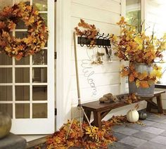 black rack and fall leaves for front door decoration