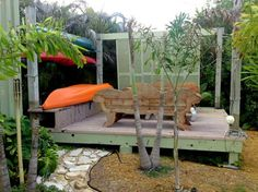 deck made from re purposed wood and salvage items.. love the privacy screen