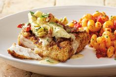 Mahi Wulfe - Lightly breaded, wood-grilled and topped with artichokes, sun-dried tomatoes and our basil lemon butter sauce