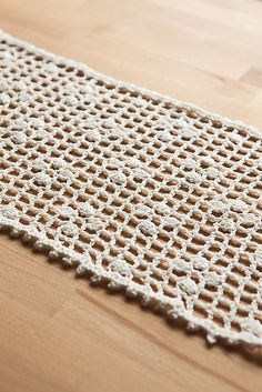 This vintage-inspired table runner is the perfect design element for your summer décor. Pretty puff stitches and an open lace border make this crochet piece the runaway hit of your handmade home.