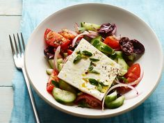 Classic Greek Salad Recipe : Food Network Kitchens - with a red wine vinegar/lemon/honey/oil dressing