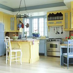 Warm and Cool Mix-love yellow, blue and white kitchens!