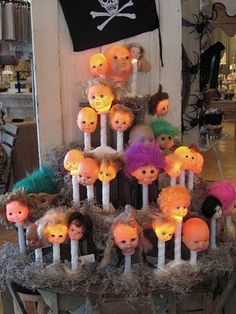 single window candles with doll heads on top!!!!  This is amazing!!!!