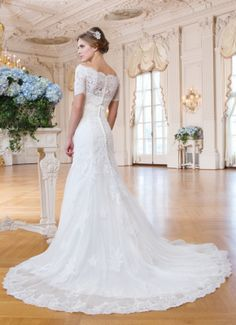 Stunning full lace wedding gown with detachable bolero by lillian west style 6365