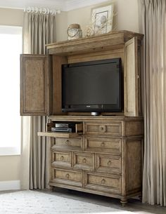 """This grand armoire offers great style and function to a bedroom or living room entertainment space. The top of the chest can accommodate a flat-panel TV up to 50"""". The top left-side drawer has a drop-front for easy use with an electronic component."""