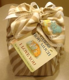 great idea, wrapping a baby shower gift with a baby blanket and attaching a board book instead of a card! clever!