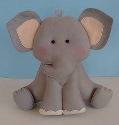 Elefante em feltro para decoração, fica em pé sem apoio.    Altura aproximada: 25 cm  Largura aproximada: 30 cm