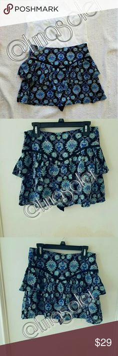 """NWT Black Blue Trippy Abstract Floral Skort Aus6 8 New with tags. Black skort with cobalt blue, bright aqua, red, & white abstract floral print. Hidden black shorts. Black piped v-cut front & back detail. Tiered layers. Concealed side zip. Cotton/Poly blend. By Mika & Gala. Retailed for $128 at LF.   **Sz 6 & 8 (Aus), which have been converted into US XS & S in buying options.** Approx. Flat measurements: waist= 13.25"""" & 14"""" respectively. Outseam= 13.75"""". LF Shorts Skorts"""