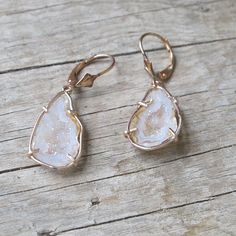 """Peach geodes in hand forged 14k rose gold frames with lever back ear wires. 2"""""""