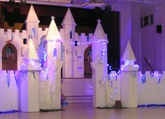 Ice Castle set on stage and floor, a stunning backdrop for Frozen Characters to perform their magic