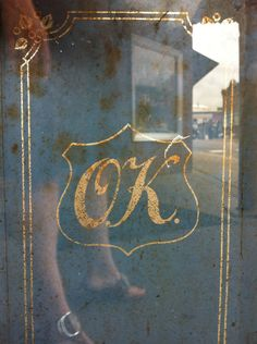 Gilded letters on window #vintage #badge