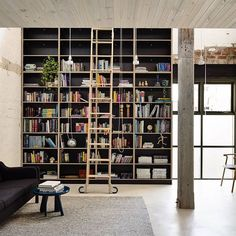 Custom film ply bookshelf created for a warehouse conversion in Fitzroy. Plenty of room for a good book or 2. Black film ply from @maxiplywood architecture design @architectseat photo @derek_swalwell #cosinteriors #fitzroy #bookshelf #bookshelves #bookcase #loungeroom #livingroom #modernliving #study #library #libraryladder #filmply #birchply #maxiplywood #formply #plywood #australianinteriors #australianinteriordesign #warehouseinterior #warehouseconversion
