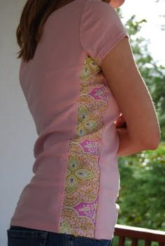 Adding a side panel to an old shirt....it's adorable and a great t-shirt refashion...you could make it roomier or smaller whichever you need! Love this!!