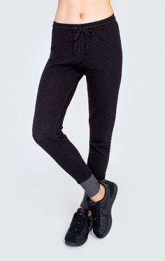 Sometimes you just have to stick with the classics! Wildfox girls love the simple things in life.  That's why we are bringing you the Fame Jogger in quilted jersey. These super soft sweatpants have a skinny fit with banded hems and a adjustable tie waist band. Zip detail at bottom. In Alabaster and Clean Black. 50% Poly, 47% Cotton, 3% Rayon Model wears a size small