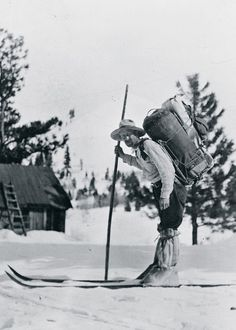 Star Mail Route Carrier Frank E. Stevens poses on skis with an 80-pound pack of mail on his back in 1920. Stevens carried mail on the Rocky Bar to Atlanta, Idaho, mail route – one of the most dangerous in the country. From 1892 to 1913 seven carriers on the 16-mile route lost their lives in snowslides. The body of a carrier who died one January was not found until the following June.     collection of United States Postal Service