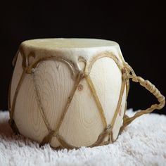 This two sided drum is hand-made from rawhide and wood. Powwow drums and hand drums have spanned many generations. It measures five inches long and seven inches thick. #handdrum #drum #music #nativeamerican #rawhide #powwow #instrument #aktalakotamuseum