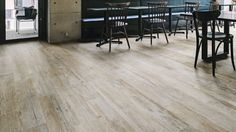 WoodRaw Powder wood look porcelain floor tile gives a lovely lime washed and lived in look and feel. Wood Effect Porcelain Tiles, Porcelain Floor, Hardwood Floors, Flooring, Rustic Contemporary, Kitchen Interior, Plank, Natural Wood, Tile Floor