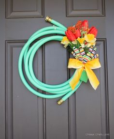 A reel welcome  This adorable wreath on your front door is a definite flow, er, show stopper. And it took the blogger behind Create.Craft.Love a mere 10 minutes to pull it together from a garden hose that cost just $7. http://www.createcraftlove.com/2013/03/garden-hose-spring-wreath.html