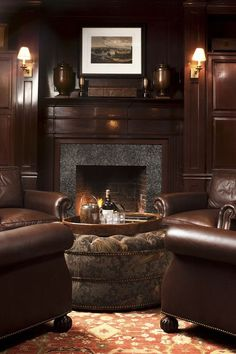 The rich wood and stone fireplace make this new traditional living room feel powerful and strong, while the leather armchairs keep it comfy and cozy