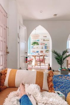 White walls are the perfect background for pops of color in the statement-making accents in this eclectic home. The bright vintage rug is the final touch for a colorful and whimsical modern home. Photo by Room Rugs, Rugs In Living Room, Living Room Decor, Moroccan Decor Living Room, Moroccan Bedroom, Moroccan Interiors, Colorful Interiors, Striped Walls, White Walls
