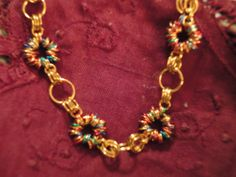 Many Colored Jumprings make up the circles around this bracelet