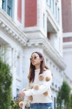 Tibi pom pom alpaca cropped sweater, here/now stella denim fox fur pom pom sneaker, Rag and bone distressed skinny jeans, Westward Leaning Vanguard Sunglasses, Chloe Grey Drew Bag, BaubleBar Caviar Pendant, Fall style trends inspiration 2017, Fall trends, Fall fashion, Fashion blogger style, pom pom trend, fashion trends 2017