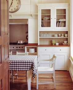 I grew up with the dining table in the kitchen. To eat and converse right in the very heart of a home is one of the most sincerest ways to make guests feel welcomed I think.