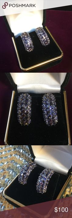 Genuine Tanzanite Earrings ! These vintage pierced earrings are a Grade  A periwinkle blue,  highly sought after color.  On today's market at retail jewelers you'll find washed out Grade B&C at premium prices.  High quality Sterling silver setting,  925mark.  You'll feel the quality of these Estate Jewelry Earrings