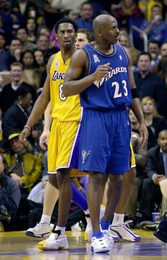 Los Angeles Lakers' Kobe Bryant, left, looks over at Washington Wizards' Michael Jordan during the second half, Tuesday night, Feb. 12, 2002, in Los Angeles. The Lakers won 103-94. (AP Photo/E.J. Flynn)