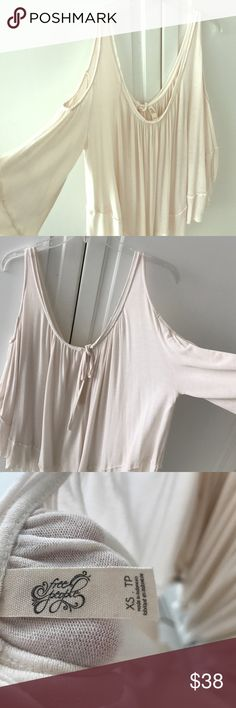 Free People cold shoulder flowy shirt Wonderfully comfortable off-white, cold shoulder flowy shirt by Free People. Sized xs, slightly worn, great condition. Scoop neck, and key-hole tie in the back. Free People Tops Blouses