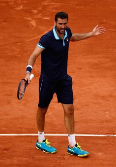 Marin Cilic of Croatia looks on during mens singles quarter finals match against Stan Wawrinka of Switzerland on day eleven of the 2017 French Open...