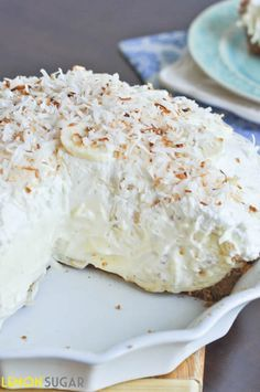 Vanilla Coconut Banana Cream Pie Recipe ~ Says: Sky-high banana cream pie made with a vanilla filling and topped with toasted coconut, this easy pie is sure to impress!