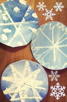 "watercolour snowflakes... My kids love to draw ""invisible snowflakes"" with white crayon on white paper. Then when they paint over them with watercolor, the snowflakes appear like magic."
