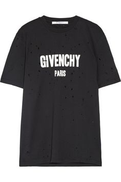 Givenchy's black T-shirt is cut from distressed cotton-jersey for a love-worn, vintage feel. This piece has a loose fit and is printed with the label's iconic block lettering. Wear yours with tailored pants and studded ankle boots.