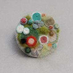 """Brooch depicting overgrown petri dish."" by Elin Thomas."