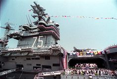 The aircraft carrier Harry S. Truman (CVN 75) is commissioned on July 25, 1998 at Naval Station Norfolk.