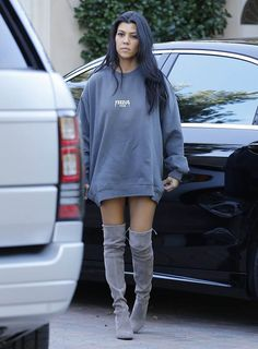 Kourtney Kardashian wearing Vianel Iphone Case in Cranberry Croc, Stuart Weitzman Highstreet Boots and Yeezus Tour Sweatshirt Kourtney Kardashian, Estilo Kardashian, Estilo Kylie Jenner, Kardashian Style, Kendall Jenner, Kardashian Photos, Sweatshirt Outfit, Oversized Hoodie Outfit, Teen Fashion
